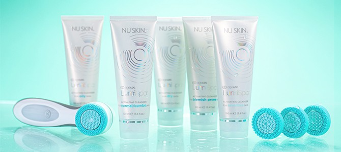 ageloc lumispa facial cleansing device by Nu Skin with treatment heads and cleansers