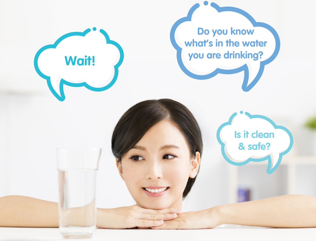 A woman looking at a glass of water questioning if the water is clean and safe.
