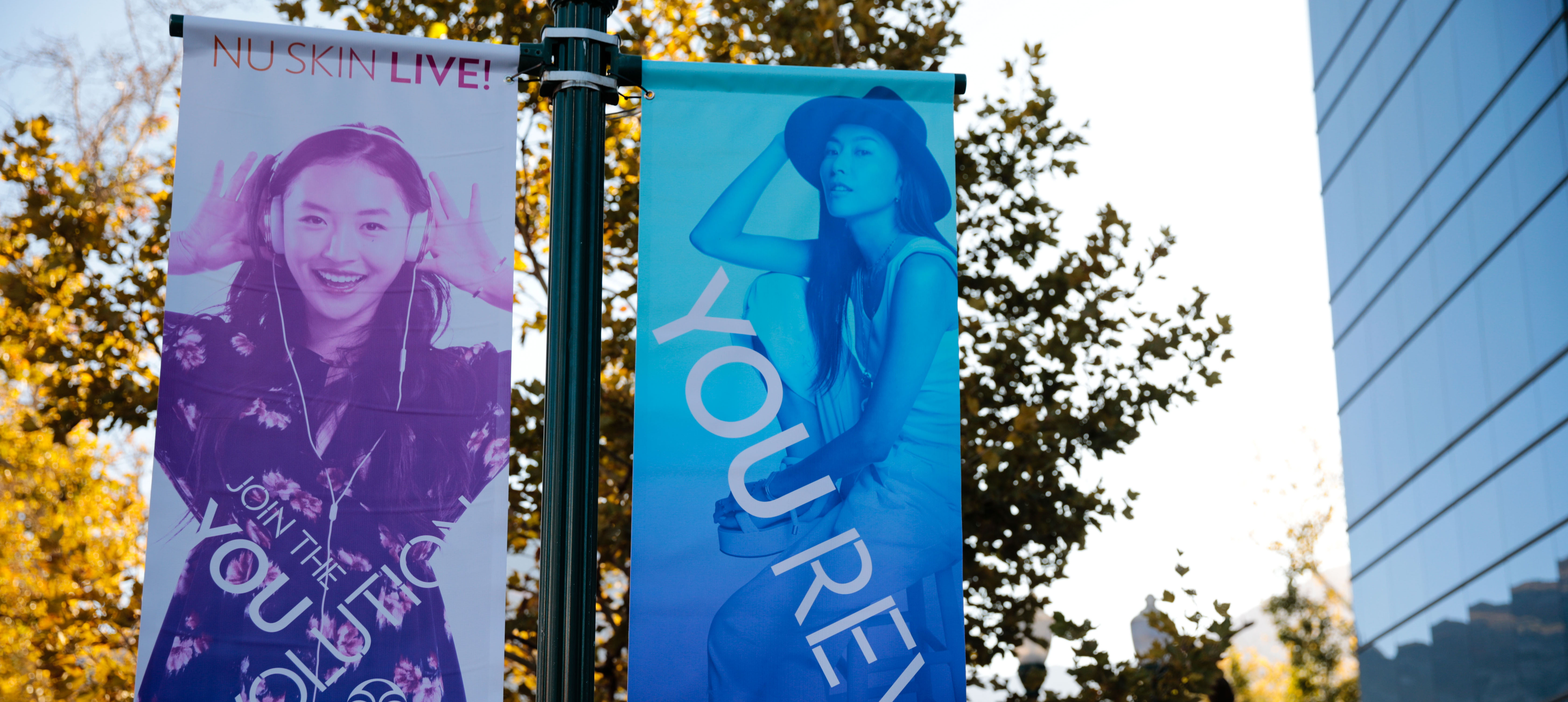You Revolution banners hang on a light pole in front of the Nu Skin corporate office in Provo, Utah.