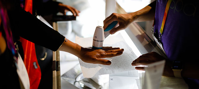 Nu Skin distributors and customers test out the new Lumi Spa on their hands at Nu Skin LIVE!